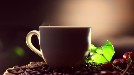 Fototapete - Coffee. Cup of hot coffee closeup and real coffee beans. 4K UHD video 3840X2160