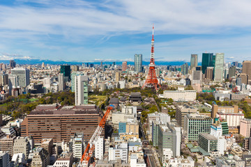 Tokyo cityscape of building and red tower blue sky background