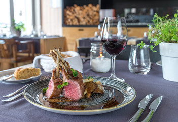 Roasted lamb chops with chanterelles and vegetables on decorated table