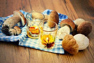 Basket with fresh penny bun  mushrooms on table
