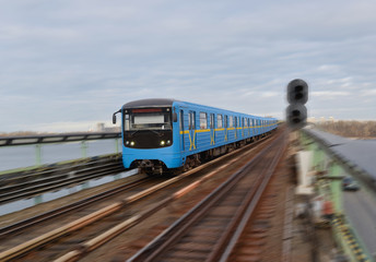Metro train in motion. Kyiv. Ukraine. Metro railway connecting districts located on right and left banks of Dnieper River.