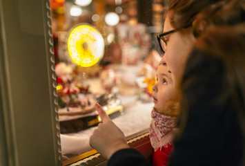 Two girls looking at a Christmas shop window