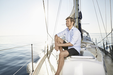 "Mediterranean Sea, ""Goldene Rente"", mature man enjoying the ride on his sailing boat"
