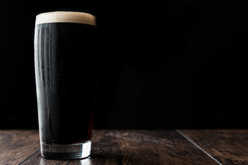 Obraz Dark beer on wooden surface. copy space. - fototapety do salonu