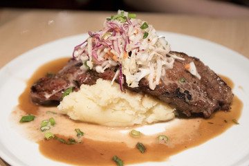 delicious steaks on mashed potato