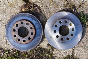 One old damaged and another new brake discs