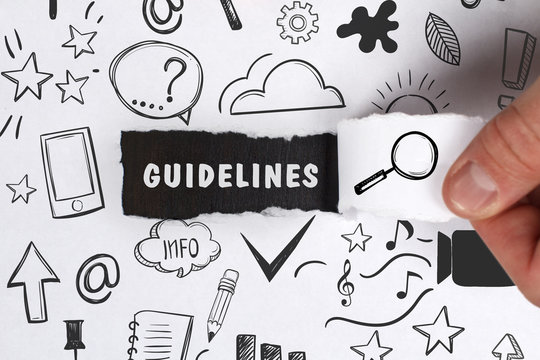 Business, Technology, Internet and network concept. Young businessman shows the word: Guidelines