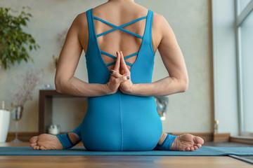 Flexible female yogi posing to camera