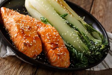 Soy-Honey Glazedsalmon and roasted cabbage bok choy close-up. horizontal