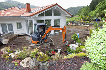 Europe, Germany, Rhineland Palatinate, Workers transferring drainage pipe in house building
