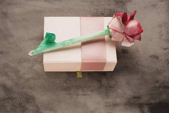 Origami watercolor rose on rose box vintage grey background