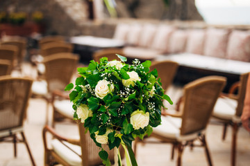 Flower compositions at the wedding ceremony. Wedding in Montenegro by the sea.