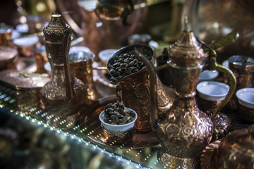 Traditional handcrafted copper coffee pots in souvenir shop in Sarajevo