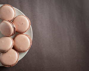 Fotobehang Chocolate pastel brown Macarons or Macaroons on a plate