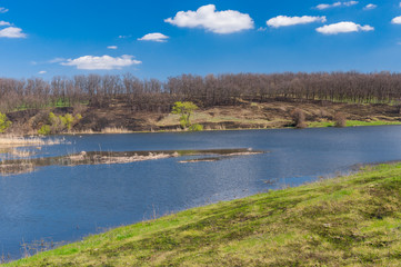 Spring landscape with Suha Sura river in Vasylivka village near Dnepr city, in central Ukraine