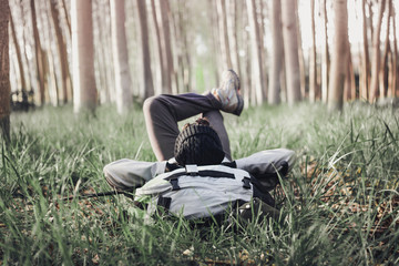 Man backpacker lying