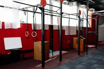 Crossfit gym. Interior shot of a weightlifting and crossfit gym. Fitness studio