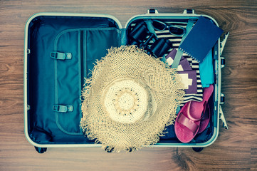 Travel suitcase with clothes and accessories. Toned image