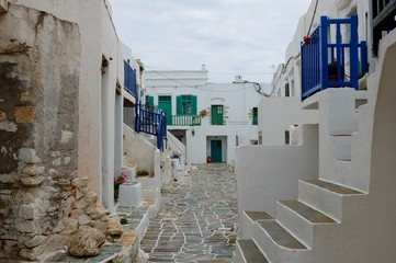 After rain on island of Folegandros/Spring in Cyclades Islands there are rain. Typical architecture in white and blue tones, design of wood, stone and slabs. From a trip to Mediterranean