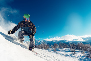 snowboarder is sliding with snowboard