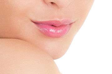 Beautiful female lips. Part of the face. Photo closeup