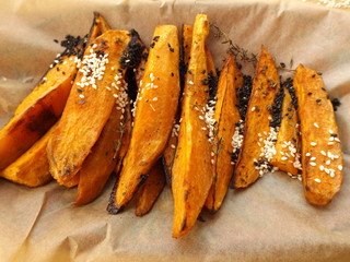 Baked sweet potato sprinkled with sesame seeds