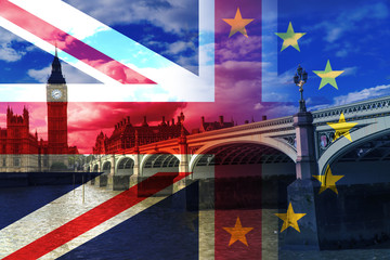 Big Ben against cloudy sky, London, United Kingdom with flag