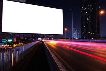 blank large billboard near night street, city for advertisement.