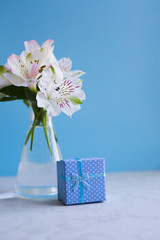 Beautiful tender bouquet of Alstroemeria with blue gift box