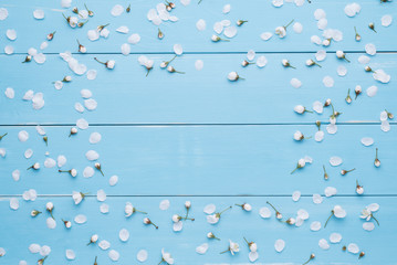 Floral frame for text on a blue wooden background