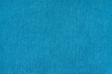 Texture of blue synthetic fabric. Pile background image.