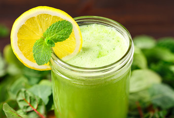 Fresh Organic Green Juice with Lemon Slice and Mint
