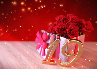 birthday concept with red roses in the gift on wooden desk. nineteenth. 19th. 3D render
