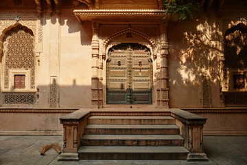 Wooden gate of an ancient temple in Vrindavan, India