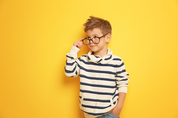 Cute stylish boy on color background Wall mural