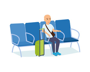 Man with luggage in hands in armchair of the airport.