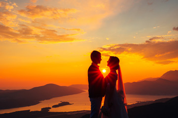 Silhouettes at sunset on Mount Lovcen in Montenegro