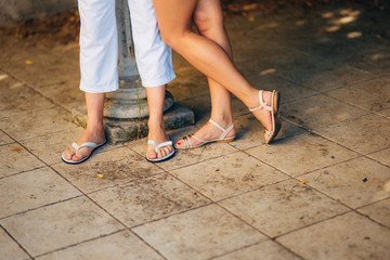 Female and male feet on the pavement. Wedding in Montenegro