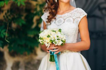 Wedding bouquet in hands of the bride. Wedding in Montenegro
