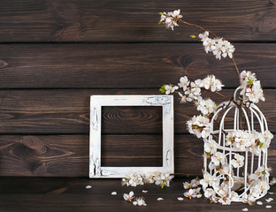 Apricot flowers in birdcage and photo frame in Shabby Chic style