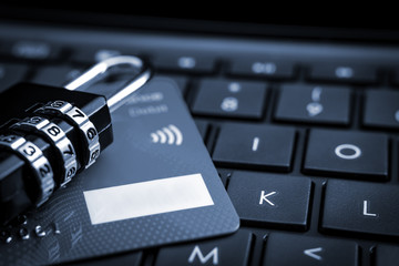 Internet payments, secure online shopping and data encryption security concept with passcode combination padlock and credit card on computer keyboard, closeup with copy space and selective focus