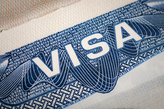 Close up on USA visa in a passport. A visitor needs a valid US visa to present to the CBP officer (customs and border protection) to enter the United States of America