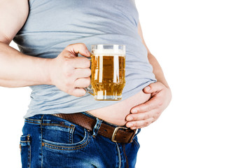 Man with big stomach with a glass of beer in his hand.