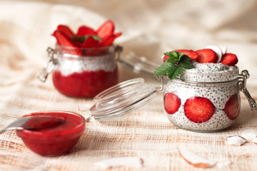 Chia pudding with strawberries in small bowls on a linen tablecloth