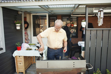 Man preparing food in back yard