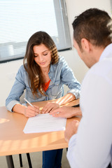 beautiful young woman in office with professional finance businessman buying agreement contract signature
