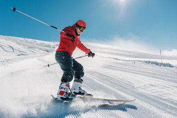 man with special ski equipment is riding very fast in the mountain hill