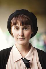 Portrait of beautiful painter wearing beret