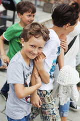 Portrait of boy walking with brothers and mother on street
