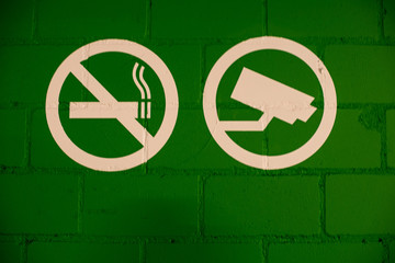 Security warning signs: Video Surveillance and  NO smoking
